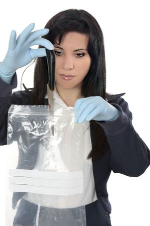 evidence bag: A woman detective collects a blood stained knife from a crime scene Stock Photo