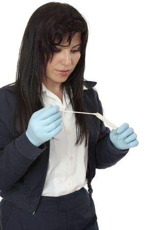 clues: A crime  investigator with a dna sample swab evidence.