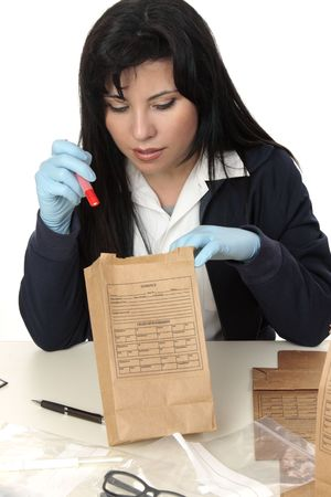 A police detective inspecting and cataloging evidence photo