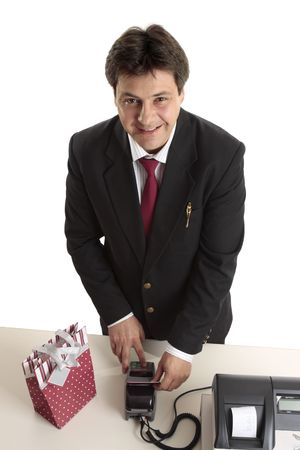 debit card: A man dressed in suit buying a birthday, Christmas or special occasion present using credit or debit card. Stock Photo