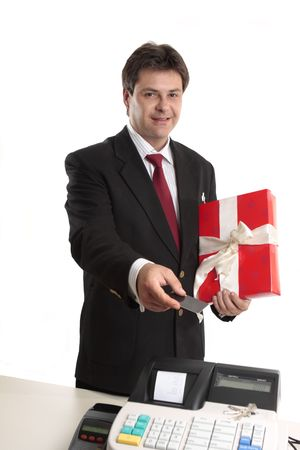 A man pays for a present with card at the checkout. Stock Photo - 3756486