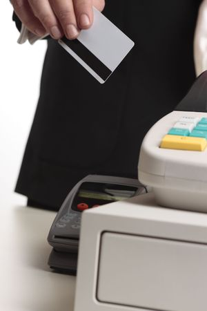 cashless: A man hands his credit or debit card at checkout for payment.   Focus to card, shallow dof Stock Photo