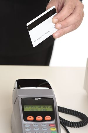 eftpos: A man uses a gift card, debit or credit card for payment at checkout.  Focus to card.   Card details removed.  Eftpos terminal is not in focus.