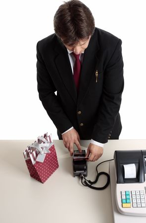 eftpos: A consumer enters pin number to make a retail payment transaction for a birthday or Christmas present.  Focus to hands