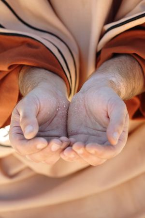 Beggar or needly person with cupped hands together in hope for a charitable assistance.  Focus to palms- shallow dof. Stock Photo - 3825661