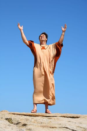 uplifting: Glory to God in the Highest, Peace on Earth, Goodwill toward men. bible verse Luke 2:14.  A holy man with arms raised toward heaven glorifying God  Stock Photo