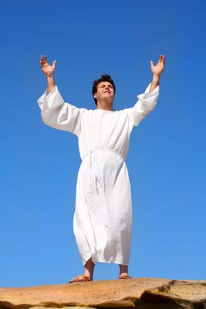 uplifting: A man raises his arms  heavenward in an act of praise or worship Stock Photo