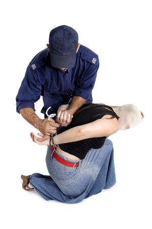 A security officer handcuffs a criminals hands behind back in an arrest