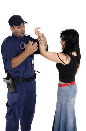 A male security officer handcuffs a female.  Cuffs show motion. Stock Photo