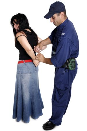 A security officer apprehends and handcuffs a female person.