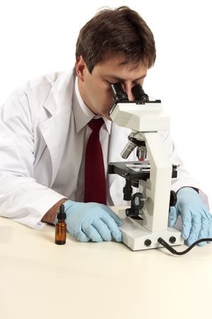 A researcher, medical or laboratory worker studies a substance under the microscope..... Stock fotó