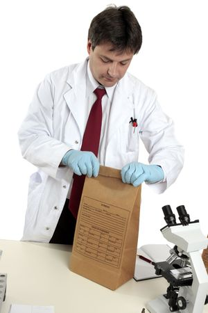 A scientist with a crime scene evidence bag Stock Photo - 3975862