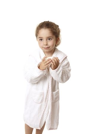 Little girl in bathrobe ready for bathtime, she is holding a bar of soap Stock Photo - 4089788
