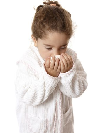 Young girl in bathrobe sniffing fragrant perfumed soap Stock Photo - 4089789