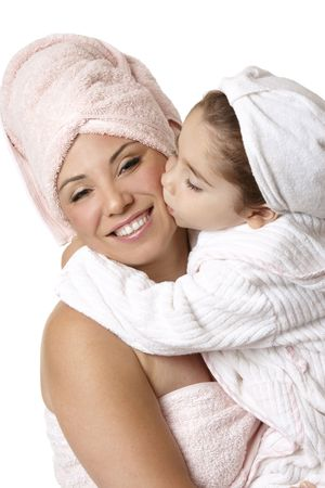 woman bathrobe: Smiling mother and daughter at bathtime