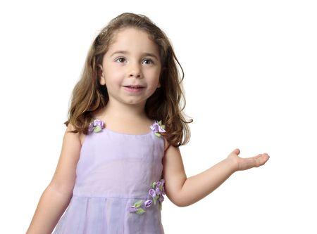 적합: Pretty smiling girl with hand outstretched palm facing upwards.  Suitable to add  your product or a message. 스톡 콘텐츠