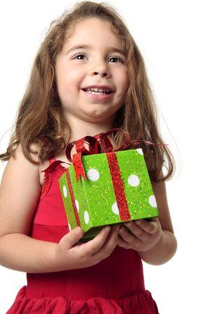 exuberant: Exuberant happy child holding a present.