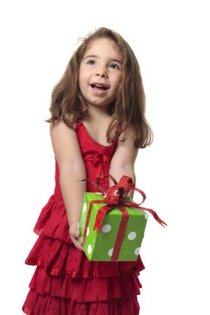 gleeful: Young happy child holding a present with gleeful smile