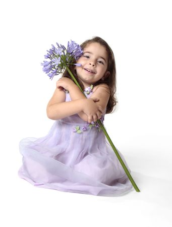 Little girl arms wrapped around a large agapanthus lily flower. photo