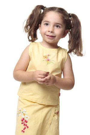 ponytails: Smiling little girl with hair pulled into ponytails