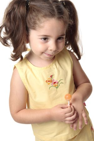 A toddler girl dressed in a yellow outfit smiles shyly Stock Photo - 4902071