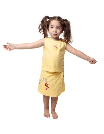 Small young girl standing with arms outstretched to the sides of her body. Stock Photo - 5147686