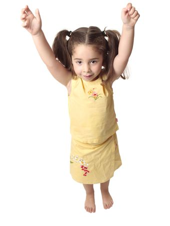 arms above head: Little toddler girl with both arms raised above her head.  She is smiling and has hair in ponytails,