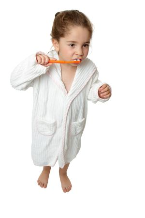 A young girl holding an orange toothbrush and brushing her teeth. Stock Photo - 5214787