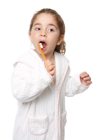 Young preschool age girl using a toothbrush to clean her teeth. Stock Photo - 5247632