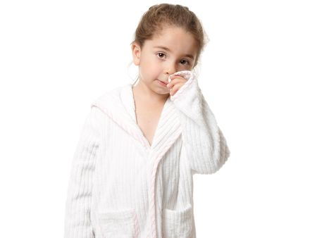 Pretty young girl standing in a white with pink trim bathrobe Stock Photo - 5247630