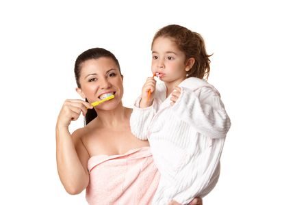 A mother and daughter brushing teeth using toothbrushes and aqua coloured mint flavoured toothpaste. Stock Photo - 5275502