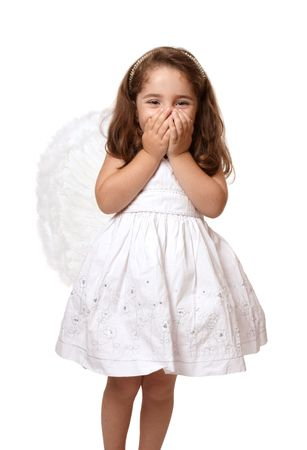 giggling: Little angel or fairy girl giggling with two hands covering her mouth