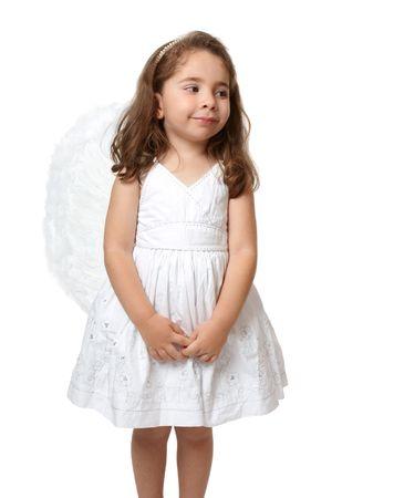 looking sideways: Angel child dressed in white looking sideways.   Stock Photo