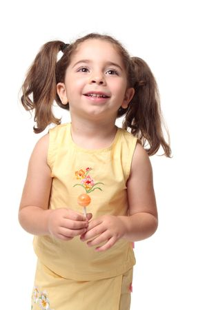 Happy laughing child in yellow outfit and hair in pigtails Stock Photo - 5364044