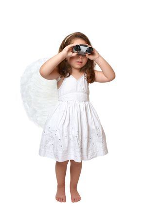 heavenly angel: A heavenly angel girl in white dress and feathered wings using binoculars to look, keep watch or see something