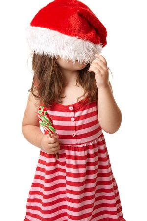 Christmas child playing with santa hat photo
