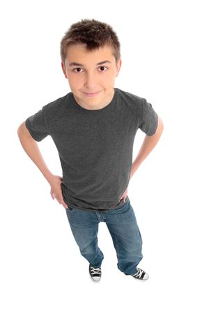 A pre teen boy standing with his hands on hips.  He is wearing a grey marle t-shirt and blue jeans. photo