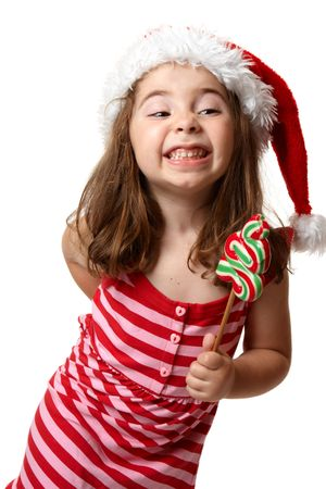 Little Christmas girl wearing a santa hat and showing a cheesy toothy smile photo