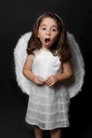 child singing: Holy angel singing carols, psalms or praising or worshipping. Stock Photo