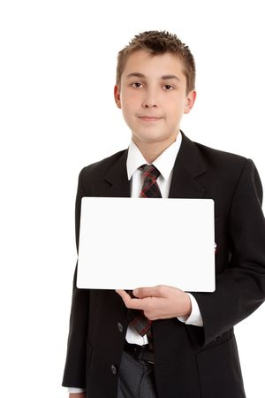 School student in uniform holding a blank sign. Stock Photo - 5532686