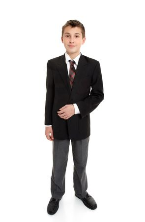 Secondary school student standing in uniform.  White background.  Shadow left under feet. Stock Photo - 5532682