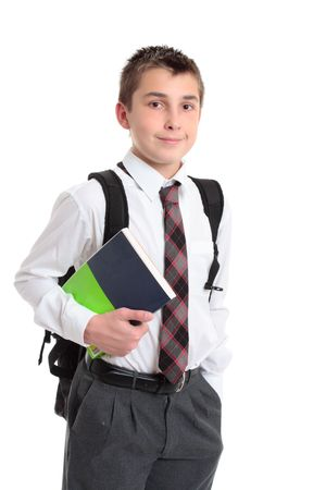 book bags: A schoolboy carrying a book and school bag. Stock Photo