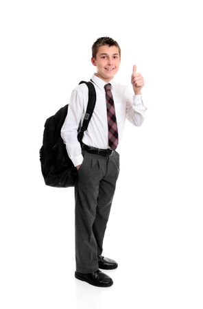 ni�o parado: Ni�o de la escuela secundaria de pie en uniforme mostrando un pulgar hacia arriba la mano firme, por ejemplo, el �xito, la aprobaci�n, grandes, etc .. Foto de archivo