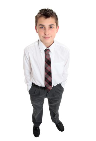 pre teen boys: A high school boy in uniform stands with hands in pockets. Stock Photo