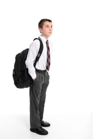 High school student standing with a school bag on his back.