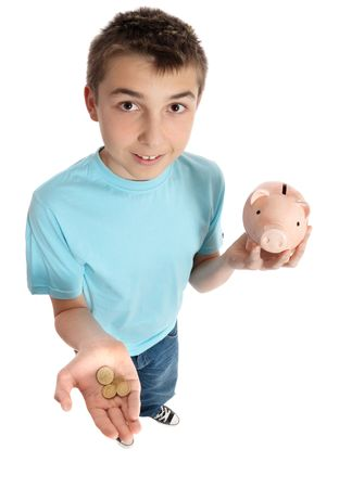 A boy with coins in the palm of his hand and money box in the other. photo