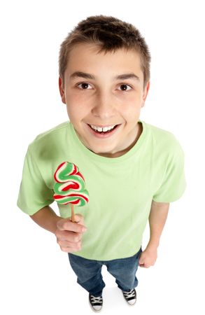 Cheerful boy holds a swirly green red and white lollipop shaped like a Christmas tree photo