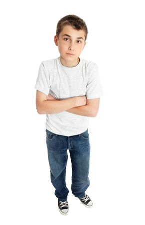 Boy pre teen standing in casual jeans and t-shirt. photo