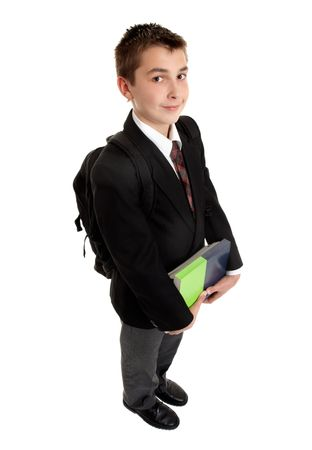 A high school student carrying some textbooks and backpack photo
