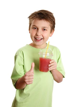 A happy, health conscious boy drinking fresh juice and showing a thumbs up sign. Stock fotó